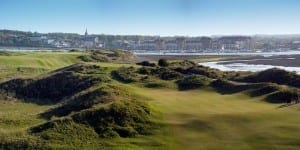 The Island golf course with hills. the town located in the far side of this picture