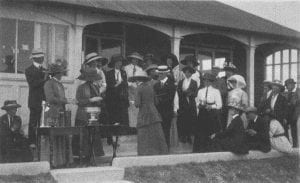 Presentation of Irish Close C'ship trophy to Mabel Harrison outside clubhouse (1911)
